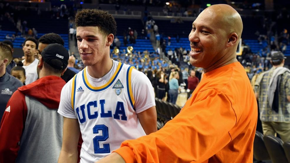 f105c4a5 20, 2016, file photo, UCLA's Lonzo Ball (2) walks by his father LaVar Ball,  right, to greet family members after UCLA defeated Long Beach State in an  ...